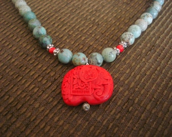 Empress Tzu-Hsi - turquoise bead and carved cinnabar elephant pendant beaded necklace
