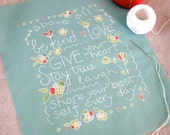 above all, be kind - stitch sampler and pillow front