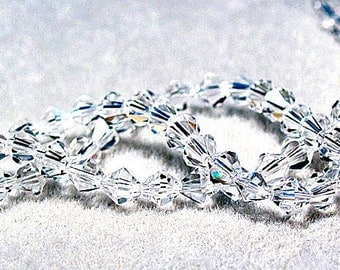 Diamond- faceted crystal bicone beads