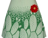 cactus flower skirt - light green and dark green - graphic nopales print with red ric rac flower