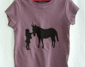 girl with unicorn silhouette t-shirt