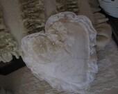 White heart shaped pillow