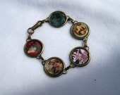 Women's hand crafted antique brass link bracelet with images of women and stamps imbedded in resin in each link.