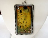 "Hand made Gustav Klimt famous painting ""The Kiss"" image sealed with resin on a silver frame, silver ball chain necklace."