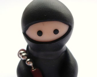 Little Black Ninja with Nunchucks