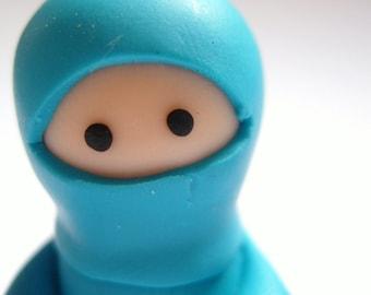Little Turquoise Ninja with Throwing Star
