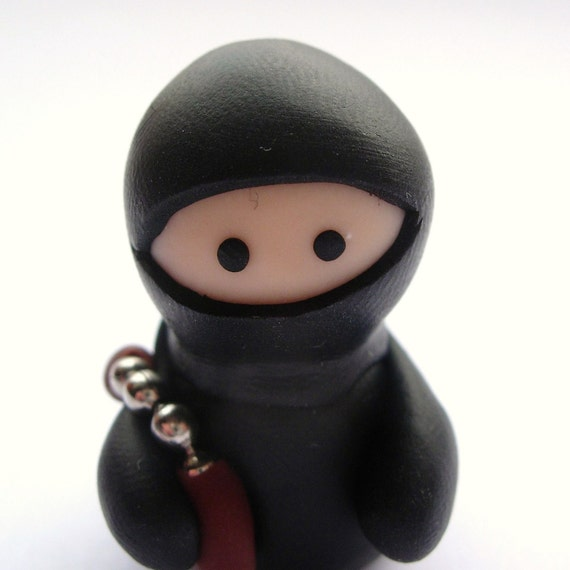Little Black Ninja with Nunchucks