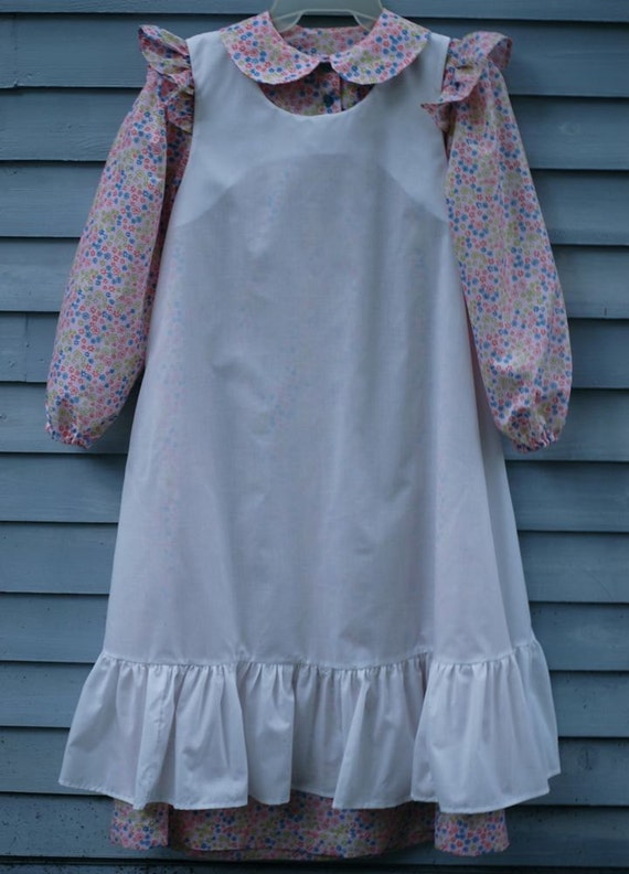 Girl, size 8/10, Pioneer/Prairie costume in Calico print on pale pink with white pinafore.