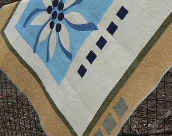 Quilt with a Blue Flower