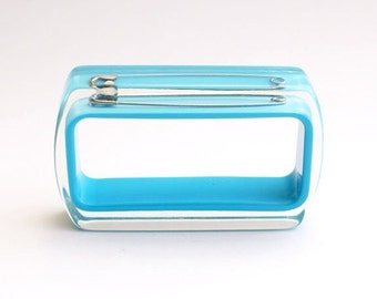 Blue rectangle lucite bracelet with safety pin