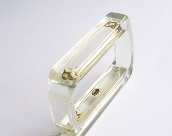 Clear lucite bracelet with safety pins