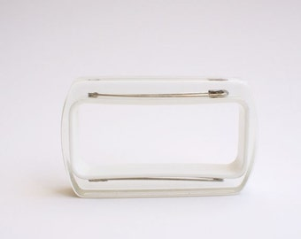 White rectangle lucite bracelet with safety pins
