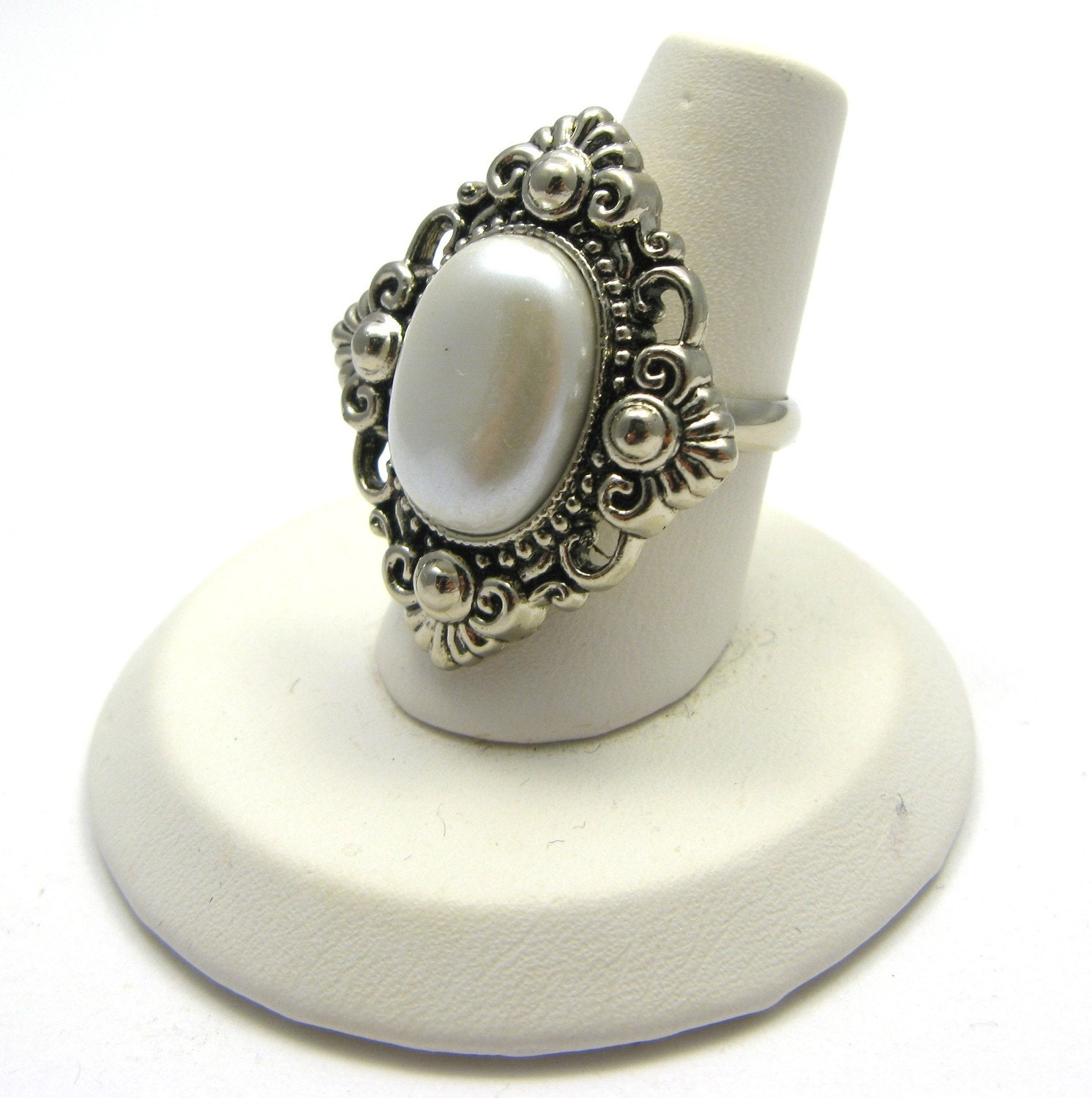 fancy costume jewelry ring silver with white center on