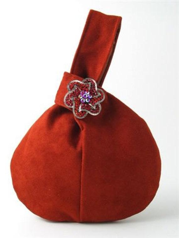 Burnt orange ultra suede wristlet bag