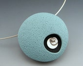 Contemporary retro mod polymer clay pendant in dusty blue on a sterling silver choker neckwire