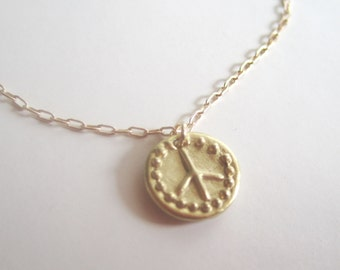 Peace pendant on gold filled chain necklace 16 inches long