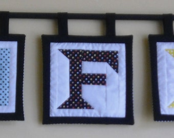 Custom Mini Alphabet Block Quilts with a flair on the edges.