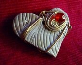 Carved Love Pendant