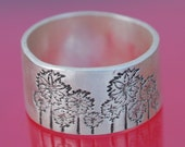 ON SALE... unisex PINWHEELS wide band ring, eco-friendly silver. Handcrafted by Chocolate and Steel