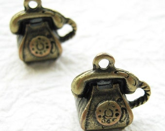 10 pcs of  tiny charms - Antique brass telephone charm