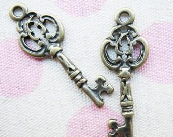 10 pcs of  tiny charms - Antique brass vintage key charm