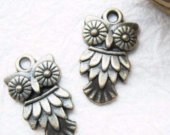 10 pcs of  tiny charms - Antique brass owl charm