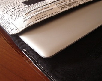 Newsprint  laptop sleeve with compartment
