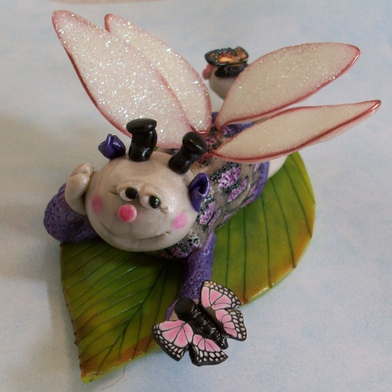 clearance was 24.95 I love Your Wings. Butterfly fairy figurine