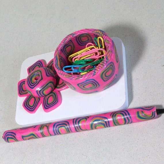 Hot pink swirls paper clip and pen holder.