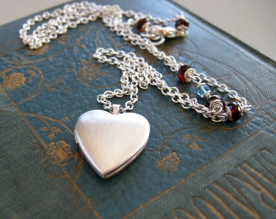 RESERVED LISTING small heart locket in sterling silver