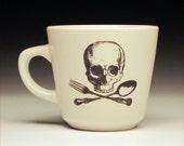 skull and cross utensils teacup
