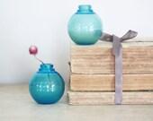 Pair of aqua blue glass bud vases