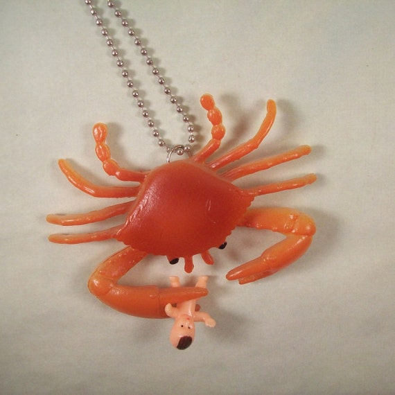 Crab Playing with a Baby Necklace