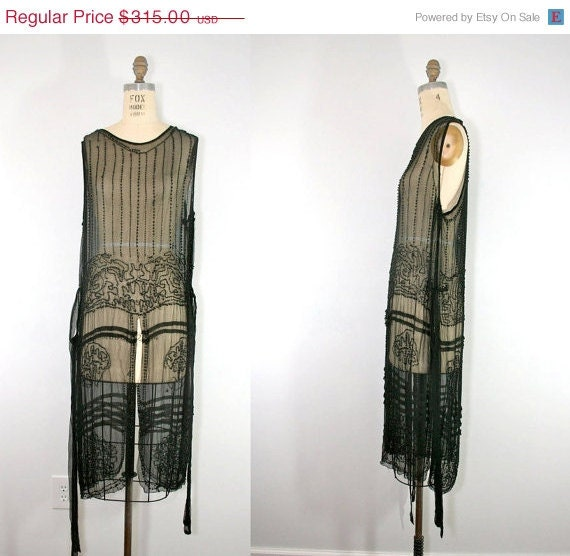 R E S E R V E D . vintage . 1920s . FITZGERALD . black . beaded . flapper . dress