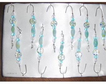 Ornament hangers in yellows, aqua, siver and yellows