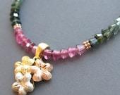 Necklace . Tourmaline . Pink green . Vintage solid 14k gold floral pendant
