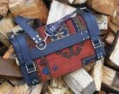 Carpet bag from Antique tribal rug Buffalo hide Mahogany Amethyst Waxed Leather