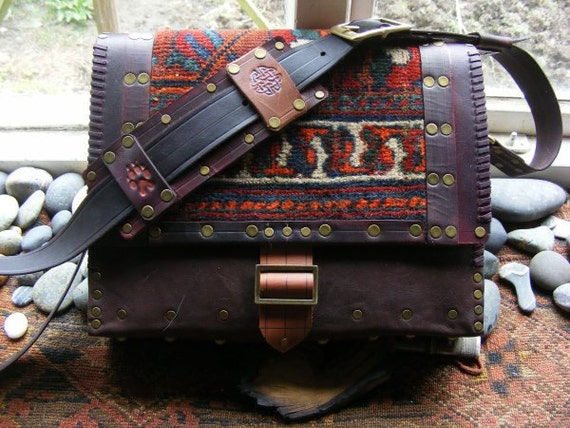 Purse in leather and antique Persian rug fragment.