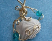CLEARANCE.....Treasures of the Oceans wrapped wire pendant in gold with seashell