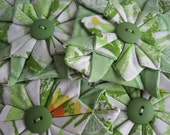 Four Fabric Folded Origamin Flower Embellishments With Buttons