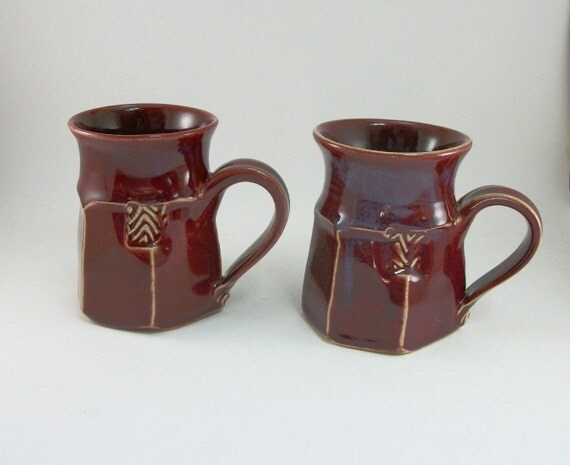 impossibly awesome pair of red mugs
