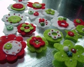 Felt flowers and shapes in a Christmas mix of colours  red, white and lime\/apple green
