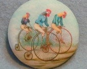 Rooster Riding Bikes  Hand Printed Fabric Covered Button 1 and 1/2 inch Diameter
