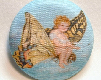 Child Riding Butterfly  Hand Printed Fabric Covered Button 1 and 1/2 inch Diameter