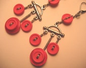 Red chandelier vintage button earrings wrapped with stainless steel wire silver coloured.