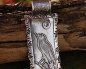 The Liitle Raven Pendant in Fine Silver