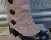 Pink plaid Burberry raincoat spats with secret silver lining