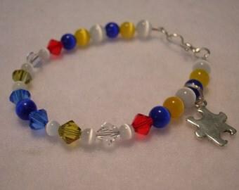 Autism Awareness Swarovski Crystal and Cats Eye Puzzle Piece Bracelet