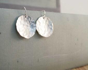 large disc earrings.