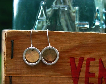 small gold disc and small open circle earring.
